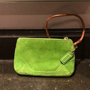 Gently used for storage suede wristlet by Coach
